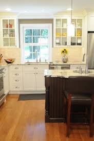 stylish antique white kitchen cabinets with black island and