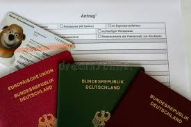 german passport application form with passports stock image