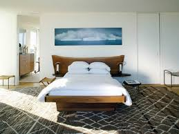 bedroom cheerful interior light brown wooden bed along wall room