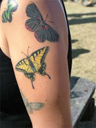 colorful butterfly tattoos on arm