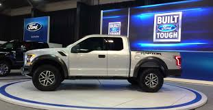truck ford raptor jurassic trucks ram rebel u0027t rex u0027 vs ford f 150 raptor