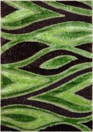 interior blue and lime green rug on grey floor with area rugs
