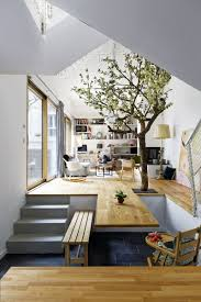Living Room With Dining Table by The Floor Of This Living Room Becomes The Dining Table Contemporist