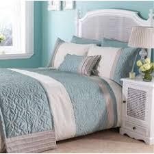 hgtv loves this dreamy coastal bedroom with seafoam green walls