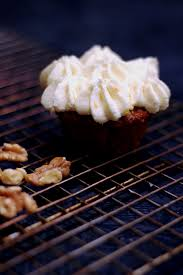 carrot cake cupcakes with cream cheese frosting snacking in the