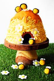 3d beehive cake with honey drips and buzzing bees supper in the