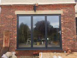 aluminium bi folding doors and slim frame windows dwl
