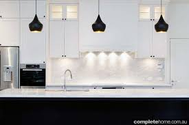 white kitchen cupboards black bench contemporary black and white kitchen design completehome