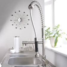 Chrome Kitchen Faucet With Spray And Decorative Wall Clock Design