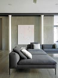 Interior Concrete Walls by Classical Columns And Concrete Walls Mix In Stylish Ny Loft