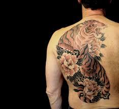 japanese flowers and tiger tattoo on left back shoulder