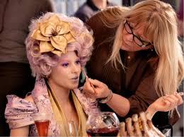 the hunger games makeup fashion lenny kravitz with gold eyeliner
