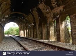 rusty train old train tunnel and rusty train tracks the train tracks between