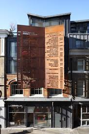 a rusty steel screens lists the occupiers of this building since