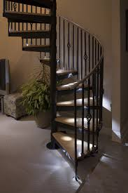 neutral mountain spiral staircase alcove luxe halls stairs