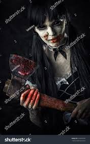 dead female zombie bloody axe halloween stock photo 223473574