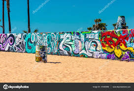 colorful graffiti on a wall and barrel at venice beach in los colorful graffiti on a wall and barrel at venice beach in los angeles california sand and palms in background photo by emyu21