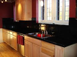 glass block kitchen backsplash and light brown granite counter