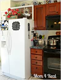 Decorating Ideas For Top Of Kitchen Cabinets by Above The Fridge Decor Kitchen Essentials Clutter And Trays
