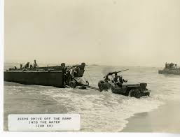 amphibious jeep a jeep tows what is possibly a 37mm anti tank gun off of an lcvp
