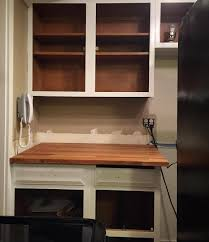before after a mini makeover for the kitchen this american house removing the old countertop was easy since we re replacing the old formica with a butcher block top that doesn t have a backsplash we did have to do a bit