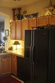 how to put lights above cabinets 25 awesome ways to use string lights in kitchens digsdigs