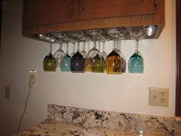 kitchen cabinet with wine glass rack installing an under the cabi wine glass shelf laluz nyc home wine