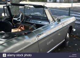 peugeot convertible old peugeot convertible car parked in french street stock photo