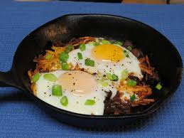 sausage hash browns and eggs breakfast skillet cooked in the