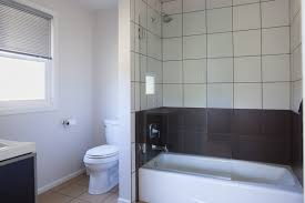 what unique glass shower door swings open for an open bath experience if desired