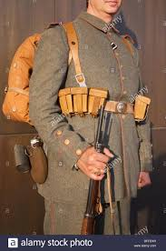soldier wearing ww i german military uniform equipped with rifle