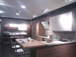 beautiful kitchen design with two windows and lovely hanging lamps