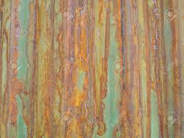 rusty green painted metal wall with cracked paint texture color