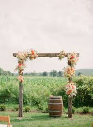 wedding arches at hobby lobby rustic wedding arch picture of rustic wedding arch with some orange and flowers baseball wedding rings jpg