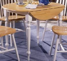 small round drop leaf dining table with white painted legs and 4