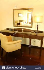bedroom dressing table sofa table lamp mirror bed painting stock