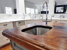 kitchen island with sink and cooktop curved pull down steel sink