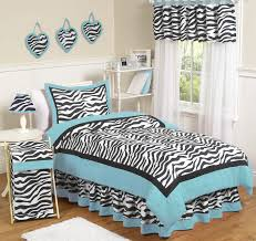 Zebra Print Table Lamp Black And White Zebra Bedding With Blue Frames On The Bed