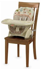 baby on fisher price space saver high chair booster seat of woodsy