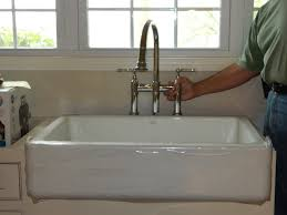 kitchen bridge faucet room for faucet holes behind kohler whitehaven sink