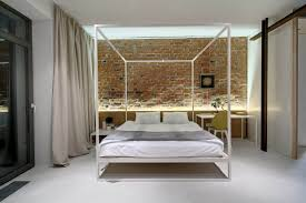 bedroom with wooden canopy bed featured white curtains beautiful