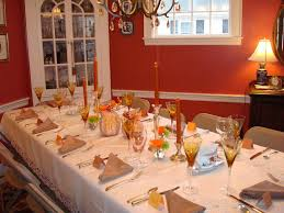 white ceramic plates and red napkin simple dining room table