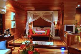Tropical Bedroom Designs Wooden Paneling Design With Elegant Four Poster Bed Using White