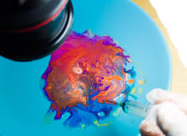 mixing paint oil and milk to create a mesmerizing cosmos of color