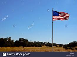 Country American Flag American Flag Billowing In A Deep Blue Clear Sky In Gold Rush