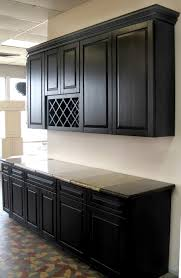 dark kitchen cabinets with light floors and kitchen island