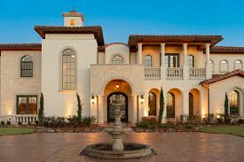 spanish mediterranean luxury home clean arches with stucco and