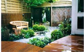 small tuscan garden design with potted plants and pea gravel