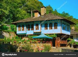 two storey house on a hill slope u2014 stock photo razvodovskij