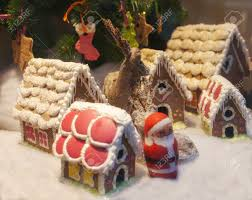 beautiful homemade gingerbread village with dear and santa